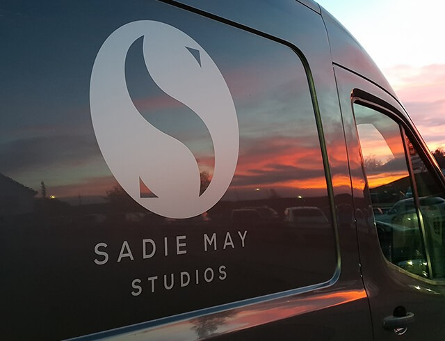 Sadie May Studios work van with logo